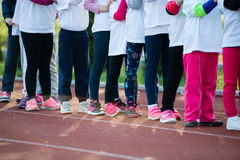 Children in ready position to run on track, closeup Royalty Free Stock Image