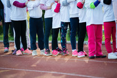 Children in ready position to run on track, closeup Stock Photography