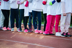 Children in ready position to run on track, closeup Royalty Free Stock Images