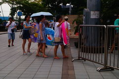 The children are ready to enter the swimming pool with a swim ring Royalty Free Stock Images