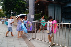 The children are ready to enter the swimming pool with a swim ring Stock Photos