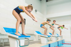 Children ready to jump into sport swimming pool. Sporty kids stock image
