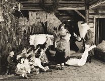 Children receiving Christmas presents from Santa Claus stock image