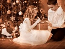 Children  receiving gifts under Christmas tree. Black and white retro Stock Photography