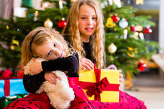 Children receiving presents on Christmas day Stock Image