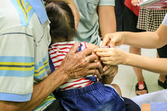 Children receiving vaccine at out side of the thigh.Children vac Stock Photo