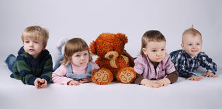 Children and red bear on bright background Stock Images