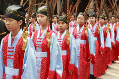 Children in Red Chinese Costumes. Young children in Chinese clothes are ready for a ceremony at the Confucian temple in Taiwan. They are students in the Royalty Free Stock Photography