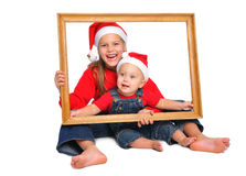 Children in red christmas hats Royalty Free Stock Image