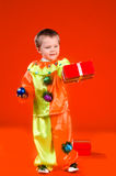 Children with red gift box. Children in fancy dress with red gift box Stock Photography