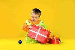 Children with red gift box. Children in fancy dress with red gift box Stock Photos