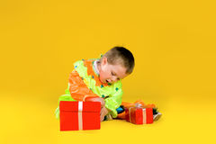 Children with red gift box. Children in fancy dress with red gift box Stock Photo