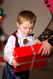 Children with red gift box. Children in fancy dress with red gift box Royalty Free Stock Image
