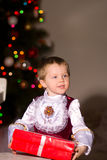 Children with red gift box. Children in fancy dress with red gift box Royalty Free Stock Photo