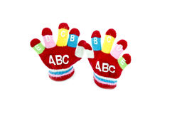 Children red glove with word ABCDEFGIJ. Isolated white background Royalty Free Stock Photography