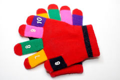 Children red mitten. Lying on each other Royalty Free Stock Photography