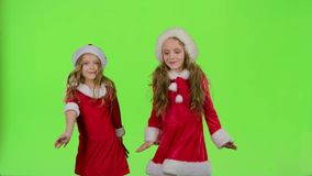 Children in red New Year costumes are dancing. Green screen. Children in red New Year costumes dance to energetic music, they are cheerful and smiling. Green stock video