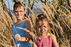 Children among the reeds Stock Photography