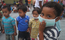 Children Refugees. Standing in the refugees camp after their village has been destroyed by mount merapi eruption in klaten, central java, indonesia Royalty Free Stock Photography
