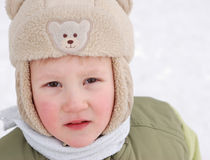 Children rejoice to the come winter. And cheerfully play white fluffy snow stock image