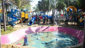 Children relax playing at modern colorful playground on yard in public garden stock video