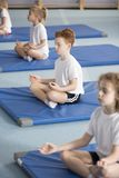 Children in relaxing meditation class royalty free stock photo