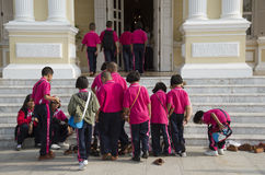 Children removing their shoes before entering building Royalty Free Stock Photography