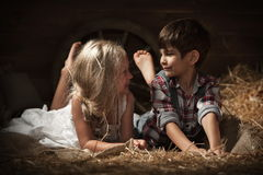 Children rest lying on straw Stock Photo
