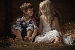 Children rest lying on straw Royalty Free Stock Photography