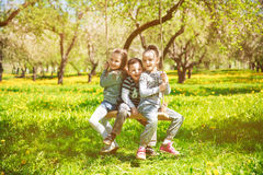 Children rest on a swing Royalty Free Stock Photography