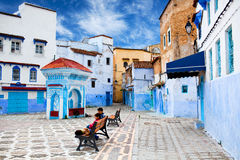 Children resting at square of Chefchaouen Medina Stock Image