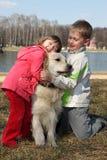 Children with retriever outdoor. Friends - children with retriever outdoor Royalty Free Stock Image