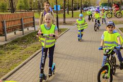 Free Children Ride Bicycles And Scooters In The Park With Pleasure. Royalty Free Stock Photography - 174367977