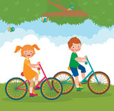 Children ride on the bike Royalty Free Stock Photography