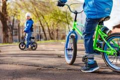 Children ride bikes in the Park stock photo
