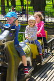 Children ride on the carousel on the childrens playground Stock Photo
