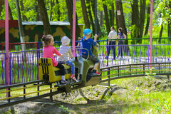Children ride on the carousel on the childrens playground Stock Images