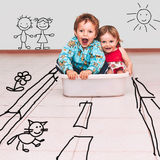 Children ride on the road painted in tub