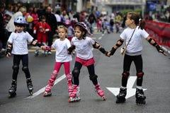 Children ride rollers at Belgrade Rollerskates Race Stock Images
