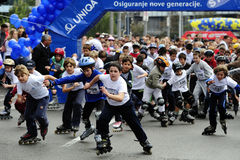 Children ride rollers at Belgrade Rollerskates Race Royalty Free Stock Photos