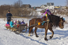 Children ride in a sleigh horse Shrovetide Royalty Free Stock Image