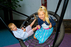 Children ride on a swing Stock Image