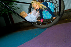 Children ride on a swing Stock Images