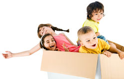 Children rideing cardbox Stock Images