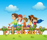 Children riding on a bicycle Stock Images