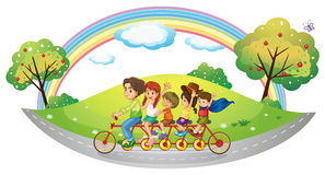 Children riding in a bicycle Stock Photos