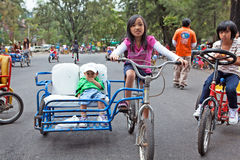Children Riding Bicycles Stock Photos
