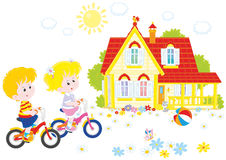 Children riding bicycles royalty free stock photo