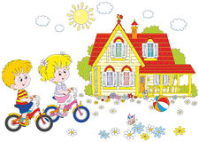 Children riding bicycles Royalty Free Stock Photos