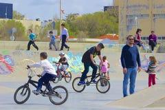 Children riding bikes in Crete, Greece Royalty Free Stock Photos